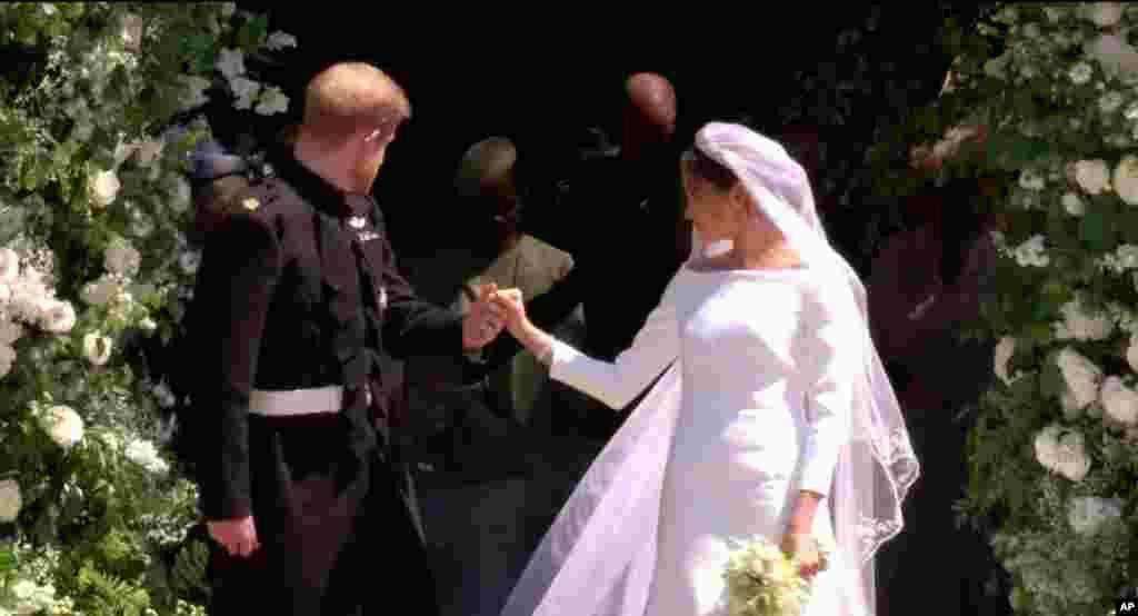 En la capilla deSt. George, Meghan Markle, se casa con el príncipe Harry, el último soltero adulto heredero de la reina Isabel II.