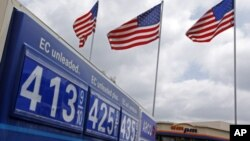 Prices at a US gasoline station (file)