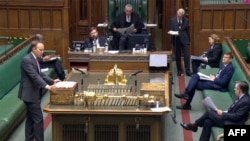 A video grab from footage broadcast by the UK Parliament's Parliamentary Recording Unit (PRU) shows Britain's Health Secretary Matt Hancock (L) giving a statement on coronavirus, Sept. 10, 2020.