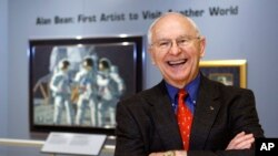 FILE - Alan Bean, the fourth man to walk on the moon, is shown during a preview of his work at the Lyndon Baines Johnson Library and Museum in Austin, Texas, Oct. 1, 2008. Bean, the Apollo and Skylab astronaut, the fourth human to walk on the moon and an