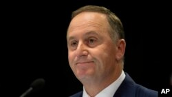 New Zealand Prime Minister John Key announces his decision to resign and stand-down from politics at a press conference in Wellington, New Zealand, Dec. 5, 2016.