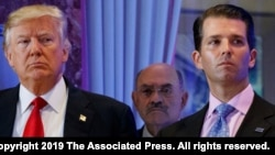 FILE - This file photo from Jan. 11, 2017, shows Donald Trump, left, his chief financial officer Allen Weisselberg, center, and his son Donald Trump Jr., right, during a news conference at Trump Tower in New York.
