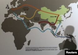 "FILE - Map illustrating China's ""One Belt, One Road"" megaproject at the Asian Financial Forum in Hong Kong, Jan. 18, 2016."