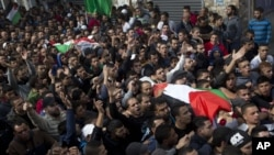 Palestinians carry bodies of Ahmed Abu al-Aish, 28, and Laith Manasrah, 21, during their funeral at Qalandia refugee camp on outskirts of West Bank city of Ramallah, Nov. 16, 2015.