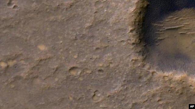 Bright dot near lower-left corner of image is three-petal lander platform from 2004 mission, Feb. 9, 2012.