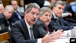 From left to right, Deputy Attorney General James Cole, Robert S. Litt, general counsel in the Office of Director of National Intelligence, NSA Deputy Director John C. Inglis, testify at a House Judiciary hearing on domestic spying on on Capitol Hill, July 17, 2013.