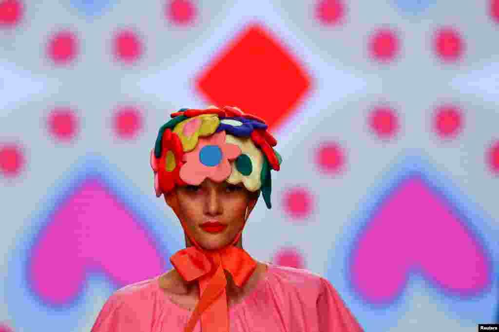 A model displays an outfit created by Agatha Ruiz de la Prada during the Mercedes Benz Fashion Week, in Madrid, Spain.