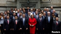 Agriculture ministers pose for the official photo at the G20 Meeting of Agriculture Ministers at San Martin Palace in Buenos Aires, Argentina, July 27, 2018.