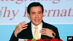 FILE - Taiwan's President Ma Ying-jeou speaks as he announces his South China Sea Peace Initiative during the 2015 ILA-ASIL Asia Pacific Research Forum in Taipei, Taiwan, May 26, 2015.