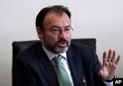 FILE - Mexico's Foreign Relations Secretary Luis Videgaray speaks to the press after meeting with Mexican senators in preparation for a trip to the U.S., where he will participate in talks with members of President Donald Trump's government, in Mexico City.