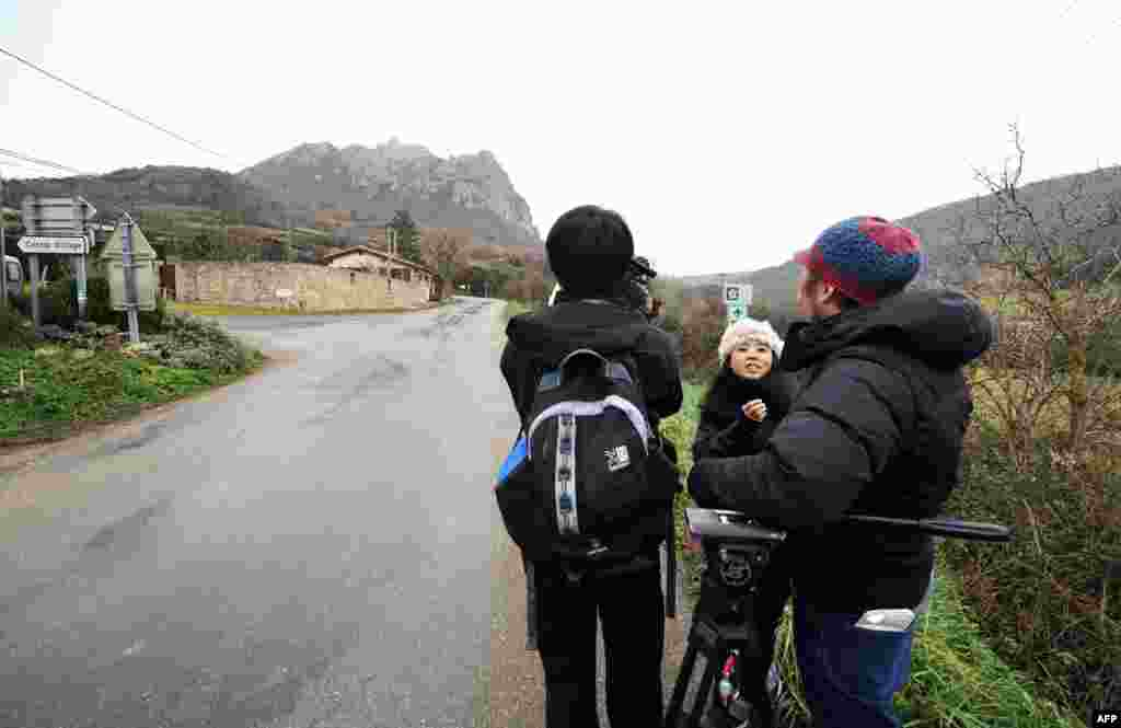 Journalists from South Korea file a report from the southwestern village of Bugarach, France on Dec. 19, 2012.