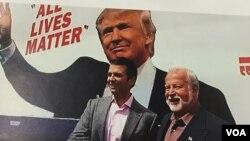 Businessman and Trump supporter Bob Bolus of Scranton, Pennsylvania, shakes hands with Donald Trump Jr. during campaign stop. (A. Pande/VOA)