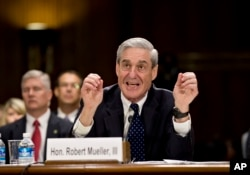 FILE - Then-FBI Director Robert Mueller testifies on Capitol Hill in Washington, June 19, 2013, before the Senate Judiciary Committee.