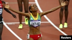 Ethiopia's Meseret Defar celebrates after winning the women's 5,000-meter final during the London 2012 Olympic Games at the Olympic Stadium, August 10, 2012.