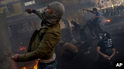 Palestinians Protest During West Bank Funerals