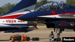 FILE - Pilots of China's J-10 fighter jet from the People's Liberation Army Air Force prepare before a media demonstration at the Korat Royal Thai Air Force Base, Thailand, Nov. 24, 2015. Bangkok is increasingly looking toward Beijing for military hardware purchases.