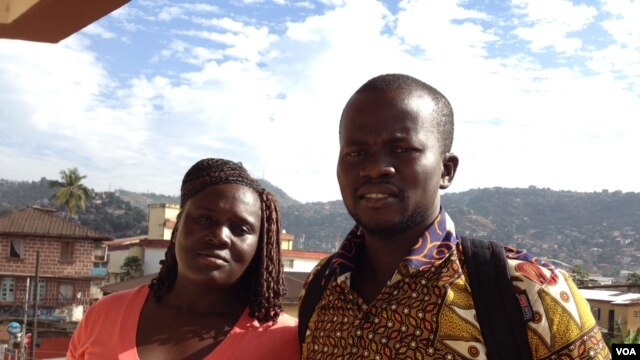 Ebola survivors Massah Stevens and Yusif Koroma stand outside the Sierra Leone association of Ebola survivors, in Freetown, Sierra Leone, Jan. 6, 2016. (Nina Devries /VOA)