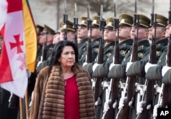 Georgia's President Salome Zourabichvili reviews the honor guard during a welcome ceremony at the Presidential palace in Vilnius, Lithuania, March 7, 2019.