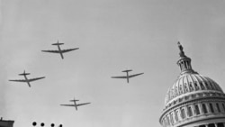 Air Force planes fly over the Capitol building on January 20, 1949, during the inaugural parade for President Harry Truman