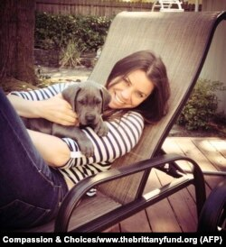 FILE - Cancer patient Brittany Maynard, shown with her Great Dane puppy, took a lethal dose of medication prescribed by a doctor.