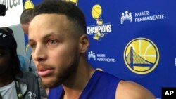 Golden State Warriors Stephen Curry takes questions from the media after NBA basketball practice in Oakland, California, Sept. 23, 2017.