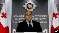 Один из сотрудников госбезопасности Грузии на пресс-коференции в Тбилиси, Грузия