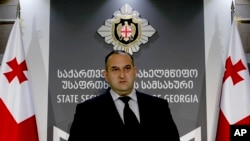 FILE - Georgian security service investigator Savle Motiashvili speaks during a news conference in Tbilisi, Georgia, April 18, 2016. On Thursday, he announced the arrest of five Georgian citizens in connection with an attempt to sell uranuim.