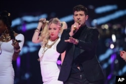 Robin Thicke performs at IHeartRadio Music Festival, day 1, Sept, 20, 2013 in Las Vegas.