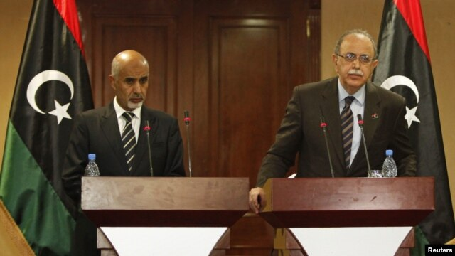 Libya's Prime Minister Abdurrahim El-Keib (R) and Head of the national assembly Mohammed Magarief attend a news conference in Tripoli, September 12, 2012.