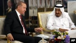 FILE - Turkey's President Recep Tayyip Erdogan, left, meets with Saudi King Salman, right, in Jiddah, Saudi Arabia, July, 23, 2017.