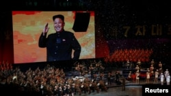 A picture of the North Korean leader Kim Jong Un appears on the big screen during a celebratory concert marking the end of the 7th Workers' Party Congress in Pyongyang.