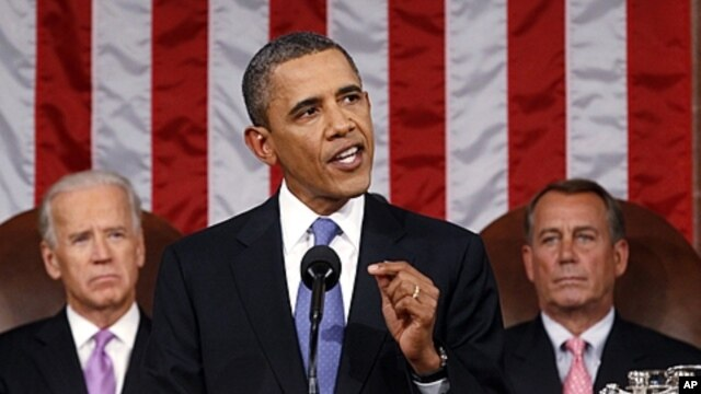 President Barack Obama delivers a speech to a joint session of Congress at the Capitol in Washington. Watching are Vice President Joe Biden and House Speaker John Boehner, September 8, 2011