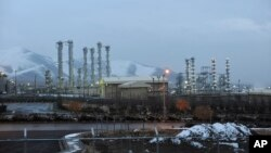 FILE - Iran's heavy water nuclear facility is backdropped by mountains near the central city of Arak, Jan. 15, 2011.