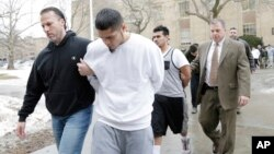FILE - Suspected members of the MS-13 gang are escorted to their arraignment in Mineola, N.Y., Jan. 11, 2018.