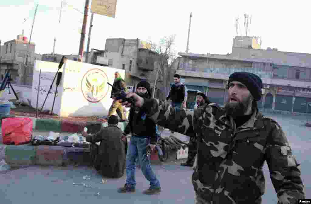 Free Syrian Army fighters are deployed in Kadi Askar in Aleppo after they said they seized it from the Islamic State in Iraq and the Levant, Jan. 7, 2014.