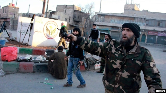 Free Syrian Army fighters are deployed in Kadi Askar, Aleppo after they said they seized it from fighters from the Islamic State in Iraq and the Levant, Jan. 7, 2014.