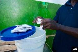 A worker prepares serum at a cholera center in Anse D'Hainault, Haiti, Oct. 11, 2016.