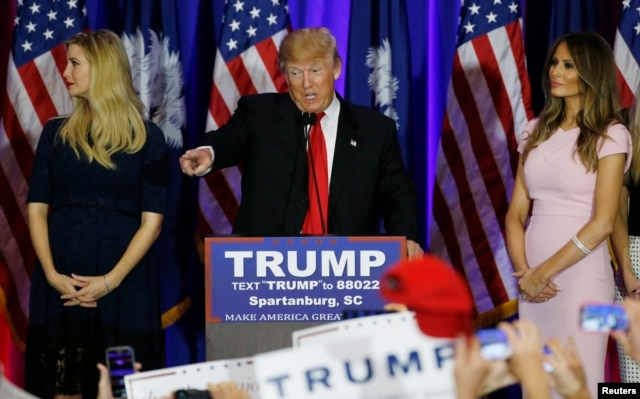 Republican U.S. presidential candidate Donald Trump, center, greets supports at a victory rally in Spartanburg, S.C., Feb. 20, 2016. On stage with Trump are his daughter, Ivanka, left, and his wife, Melania, right.