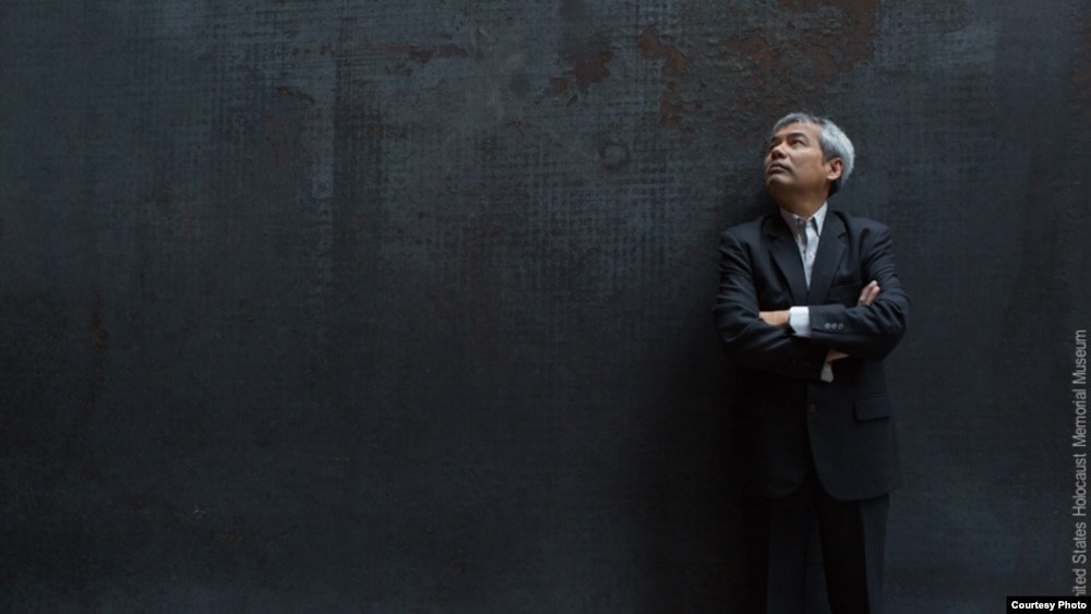 Executive Director of the Documentation Center of Cambodia, Youk Chhang stands for a portrait. (Photo: United States Holocaust Memorial Museum)