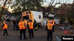 Rescue officials at the scene of a school bus crash involving several fatalities in Chattanooga, Tennessee, Nov. 21, 2016. Six children have died and the bus driving will face six vehicular homicide charges, police say.