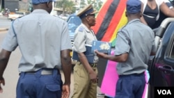 Police in Zimbabwe block protesters demanding the return of women stranded in Kuwait. (Photo: Mavis Gama)