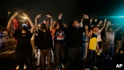 Protes atas tewasnya Michael Brown di kota Ferguson, Missouri, AS terus berlangsung selama beberapa hari (17/8).