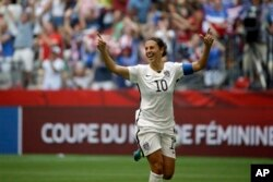 United States' Carli Lloyd celebrates after scoring her third goal against Japan during the first half of the FIFA Women's World Cup soccer championship in Vancouver, British Columbia, Canada, Sunday, July 5, 2015. (AP Photo/Elaine Thompson)