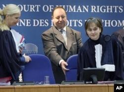 FILE - Ineta Ziemele, judge of the European Court of Human Rights, right, arrives to preside over the hearing: Abd al-Rahim al-Nashiri and Abu Zubaydah versus Poland, Strasbourg, eastern France, Dec. 3, 2013.