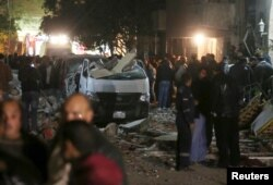 Damaged cars are seen at the scene of a bomb blast in Giza, Egypt, Jan. 21, 2016.