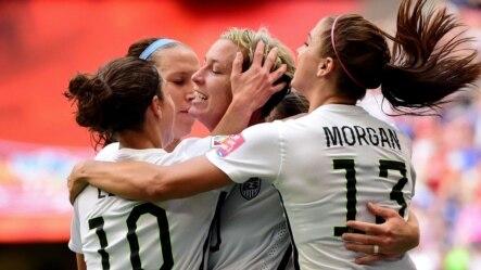 United States forward Abby Wambach (20) is congratulated by midfielder Carli Lloyd (10) and forward Alex Morgan (13)\ after scoring against Nigeria, June 16, 2015.