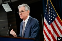 FILE - Federal Reserve Chair Jerome Powell speaks during a news conference in Washington, March 3, 2020.