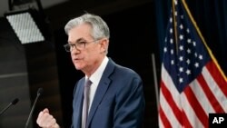 Federal Reserve Chair Jerome Powell speaks during a news conference, Tuesday, March 3, 2020, to discuss an announcement from the Federal Open Market Committee, in Washington. In a surprise move, the Federal Reserve cut its benchmark interest rate by…