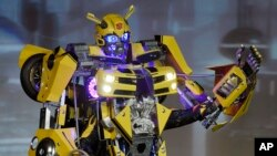 "Contestant ""Bumblebee"" waves to the crowd during the 41st Annual Comic-Con Masquerade costume competition in San Diego, California, July 11, 2015."