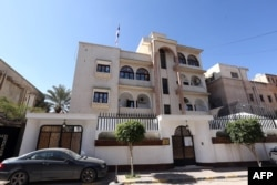 FILE - A view of the Serbian Embassy in Tripoli, Libya, Feb. 21, 2016. The day before, Libya's internationally recognized government condemned a U.S. airstrike west of Tripoli in Sabratha, believed to have killed Islamic State operative Noureddine Chouchane and dozens of others, calling it a violation of Libyan sovereignty. The strike also killed two kidnapped Serbian Embassy employees.
